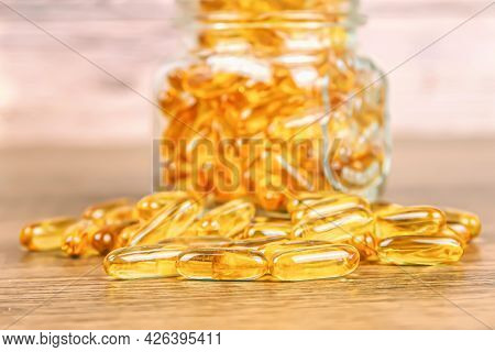 A Pile Of Cod Liver Oil Capsule On The Table For Dietary Supplement For Health-care And Healthy Eati