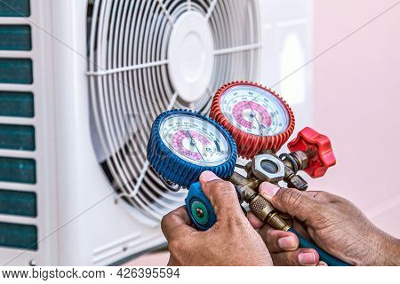 Mechanic Air Repair Using Manifold Gauge For Filling Home Air Conditioner And Checking Maintenance O