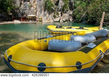 Yellow, Inflatable Boat For Rafting Down The River. Active Rest In The Mountains, In Nature. Enterta