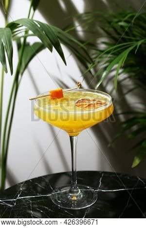 Citrus Cocktail Close Up On Marble Table And Tropic Plants On Background. Maandrin Or Tangerine Cock