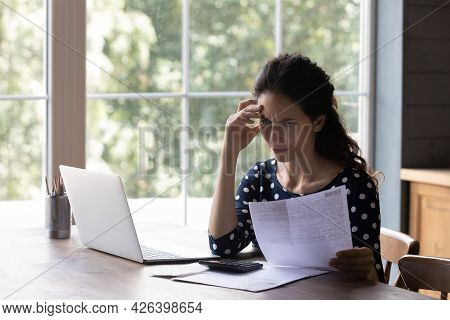 Concern Housewife Checking Utility Bill, Seeing Mistaken Too High Costs