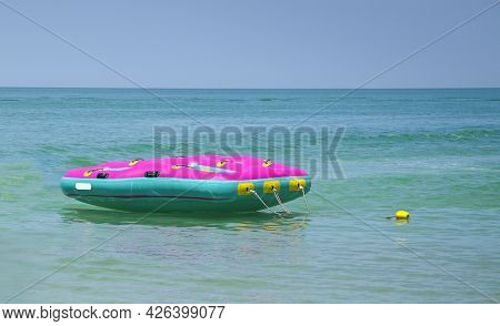 Floater In The Middle Of The Emerald Blue Sea. Hello Summer Or Summertime Concept.