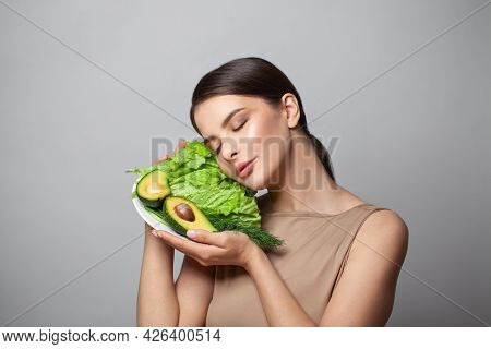 Healthy Young Brunette Woman Holding Healthy Eating Avocado With Green Salad. Detoxification, Vegeta