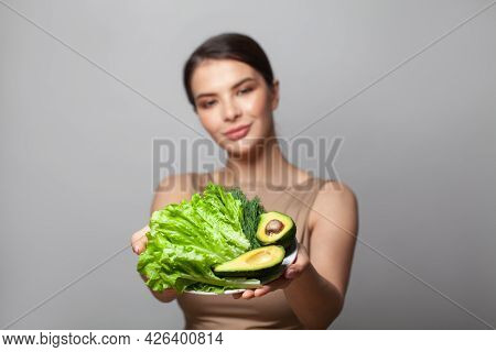 Avocado And Green Salad On Plate In Hands Beauty Young Woman. Detoxification, Vegetarian, Healthy Ea