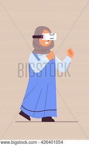 Arab Schoolgirl Wearing Vr Headset Smiling Girl In Digital Glasses Exploring Virtual Reality Interac