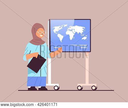 Arab Schoolgirl Presenting World Map On Digital Board Presentation Education Concept