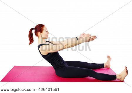 Pilates Or Yoga. A Female Pilates Coach Performs Sitting On A Gym Mat. Wellness Exercises. Isolated