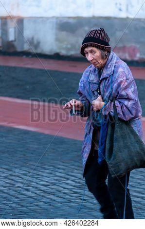 Timisoara, Romania - January 27, 2016: Woman Walking On The Street And Smoking A Cigarette. Real Peo