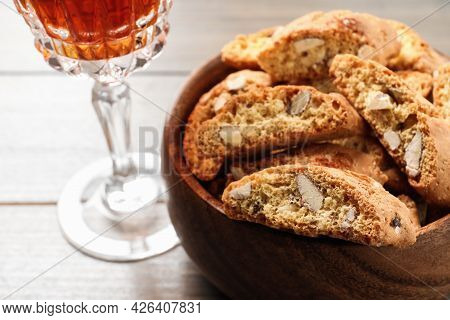 Traditional Italian Almond Biscuits (cantucci) And Glass Of Liqueur On Wooden Table, Closeup. Space