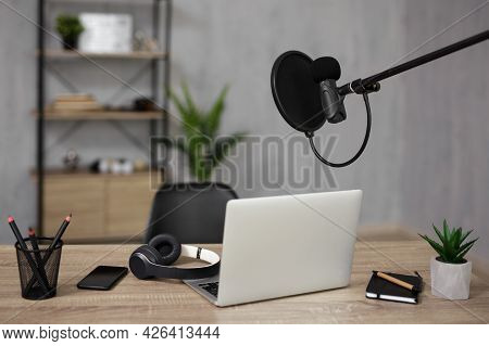 Blogging And Podcasting Concept - Home Studio Desk With Microphone And Laptop For Recording And Stre