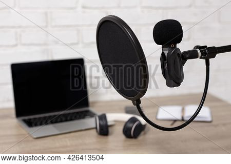 Podcast, Voice Recording And Blogging Concept - Nodern Microphone With Pop Filter And Laptop With Co