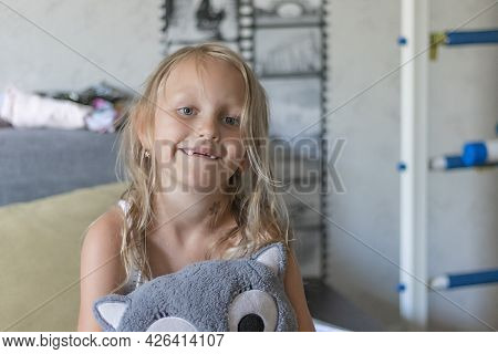 Toothless Preschool Girl, Blonde, 6 Years Old, Smiling, She Has No Upper Teeth In Her Mouth.