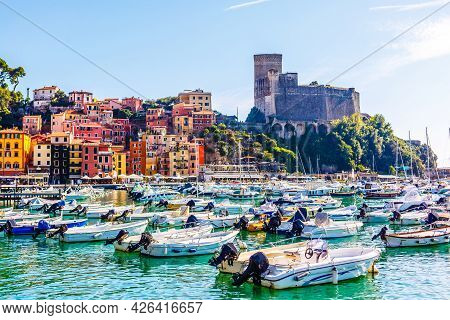 Fishing Boats In Liguria Italy. Small Fishing Boats With Fishing Equipment Docked In The Port - Leri
