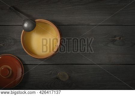 Pure Or Desi Ghee Also Known As Clarified Liquid Butter. Pure Or Desi Ghee In Ceramic Bowls On An Ol