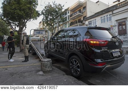 Rio, Brazil - July 10, 2021: Car Being Towed For On-day Parking Prohibited On City Street