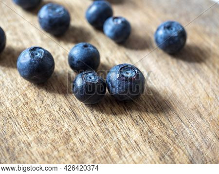 Close-up Of Ripe Delicious Blueberries On A Wooden Background. Healthy Natural Products, Vitamins. S