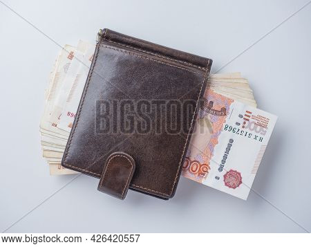 A Close-up Of A Leather Wallet Full Of 5000 Rubles Banknotes Lies On A White Background. Top View, F