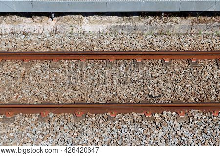 Railroad Tracks In Portugal. Part Of The Railroad. Rails, Sleepers, Ballast