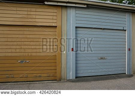 Close Up Of A Blue Closed Garage Door In A Parking Area
