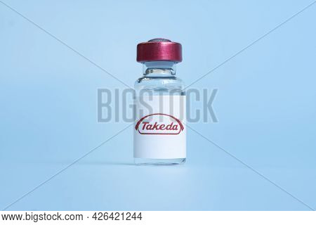 Vials Of Liquid On A White Table And The Logo Takeda, Large Pharmaceutical Company. March 15, 2021.