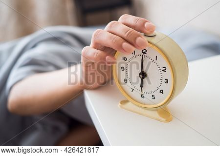 A Woman's Hand Presses The Alarm Button In The Morning. Young Woman Reach Out One's Hand Press The B