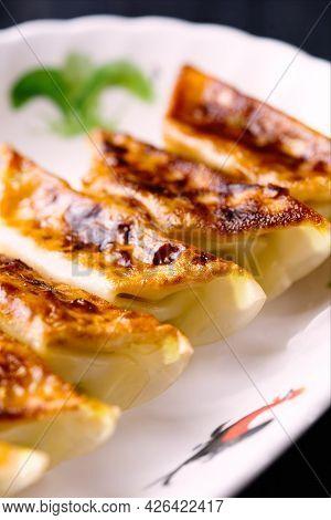 Close Up Of Traditional Asian Comfort Food Pan Fried Dumpling Gyoza