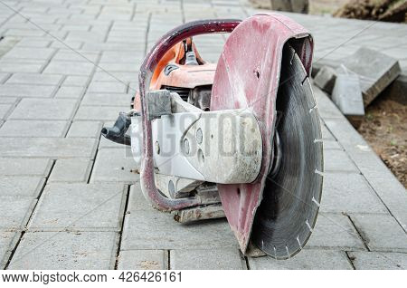 Concrete Cutter Machinery And Cutting Blade On A Driveway