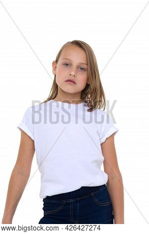 Blonde In A White T-shirt. Pretty Stylish Girl Posing In Studio On A White Background. Close-up Port