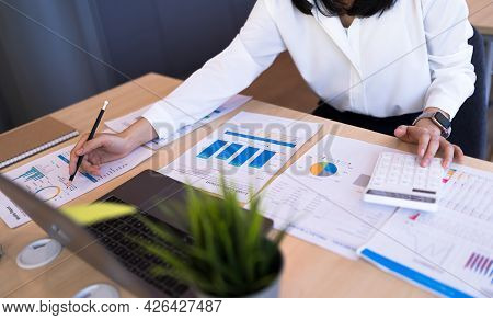 Business Financial And Tax Systems Concept. Close Up Businesswoman Or Accounting Calculating Income,