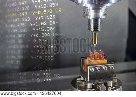 The  Abstract Scene Of Hi-precision Cnc Milling Machine Cutting The Copper Electrode Material And G-