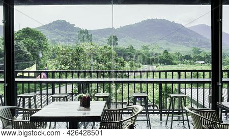 Modern Interior Chair And Table In Cafe Restaurent With Green Nature, Quiet And Chill Atmosphere In