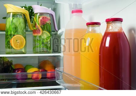 In Refrigerators Bottled Juice And Lemonade From Fresh Fruit In Decanters, Storage Of Drinks In Refr