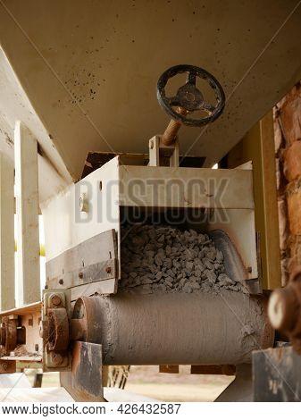 Concrete Mixer Machine Steering Wheel Presenting Around Industrial Background.