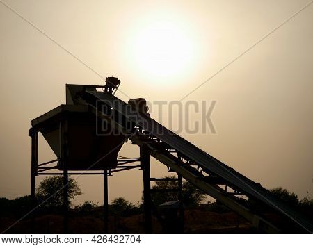 Asian Concrete Mixer Machine Silhouette Presenting Around Industrial Background.