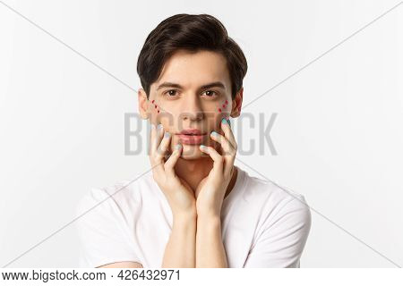 People, Lgbtq And Beauty Concept. Close-up Of Beautiful Queer Man Touching Face With Fingers With Bl