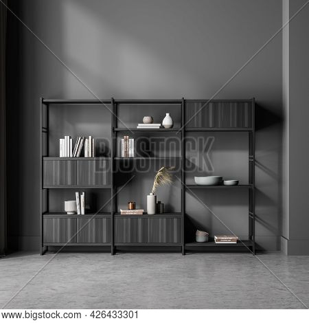 Free Standing Decorative Shelving Unit With Open And Closed Shelves, Locating At The Wall In The Gre
