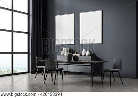 Two Banners, Locating On The Wall At The Corner Of Dark Grey Living Room. Table, Three Chairs, Curta
