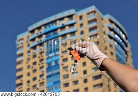 House Purchase, Woman In Protective Gloves Holding Keychain With Digital And Home Keys On Background