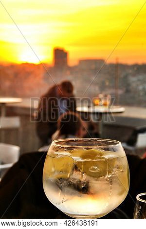 Glasses Of Gin Tonic On Table In Spain At Sunset In A Roof Terrace