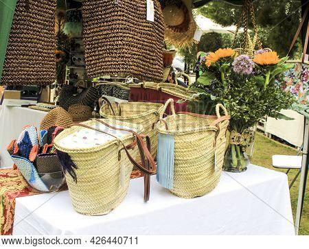 Handbag And Baskets Made Of Esparto Grass For Sale At A Market Stall