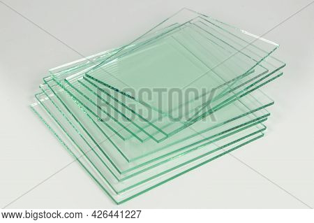 Sheets Of Factory Manufacturing Tempered Clear Float Glass Panels Cut To Size. White Background.