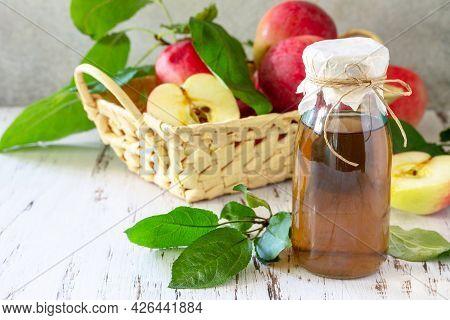 Healthy Organic Food. Apple Vinegar, A Bottle Of Apple Cider Vinegar On A Rustic Table.