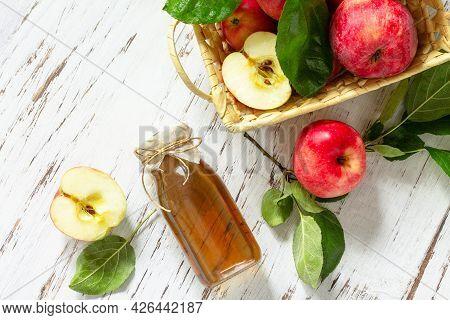 Healthy Organic Food. Apple Vinegar, A Bottle Of Apple Cider Vinegar On A Rustic Table. Top View Fla