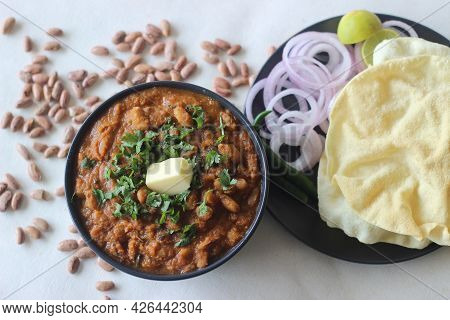 Red Kidney Beans In A Thick And Spicy Gravy Of Onions And Tomatoes. Commonly Known As Rajma Masala I