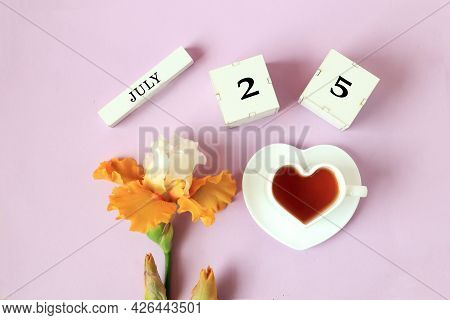Calendar For July 25 : The Name Of The Month Of July In English, Cubes With The Number 25, A Cup Of