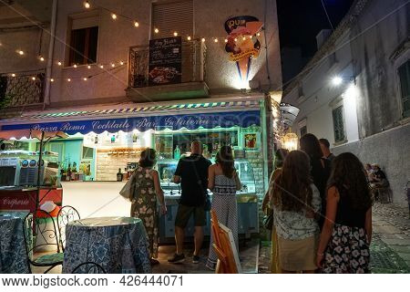 Peschici - 29/06/2021: Tourists In Front Of Ice Cream Shop In The Street, Puglia