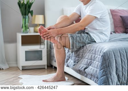 Foot Pain, Man Suffering From Feet Ache In Home Interior