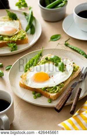 Avocado Toast With Fried Eggs And Fresh Green Peas, Coffee Cups. Healthy Breakfast, Keto Food. Dieti