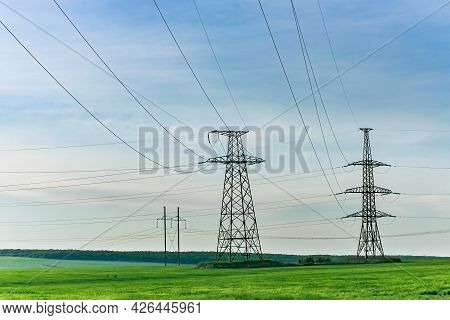 High Voltage Electric Pylon And Electrical Wire At Green Field. Electricity Pylon And High Voltage G