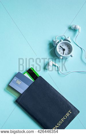 Summer Vacation Concept. Flatlay Travel Accessories On A Blue Background. Passport, Credit Cards, He